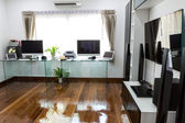 Modern office with computer and labtop with home theater — Stockfoto