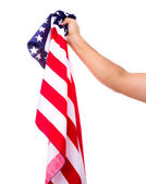 Hand holding American flag isolated on white background — Stock Photo