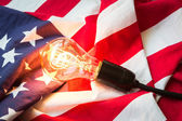 Light bulb on USA flag — Stock Photo