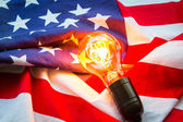 Light bulb on USA flag — Stockfoto