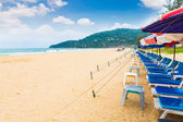 Beach chair and umbrella on sand beach — Stock Photo