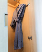 Close up of bathrobe in wardrobe — Stock Photo