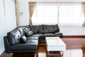 Black sofa in room — Stok fotoğraf