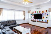 Modern room with TV and Flags for soccer championship 2014 — Stock Photo