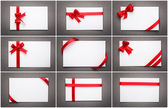 Collection of card with red ribbon bow — Stock Photo