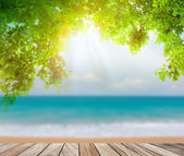 Wood terrace on the beach sea and sun light — Stock Photo