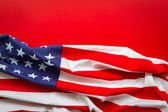 American flag on red background — Stock Photo