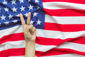 Hand over American flag  — Stock Photo