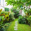 Flagstone path in home garden — Stock Photo #49817087