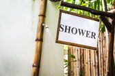 Tropical outdoor shower surrounded with bamboo walls — Stock Photo