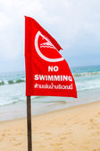 No swimming danger sign at the beach — Stock Photo