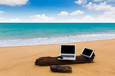 Laptop ,tablet and smartphone on the beach in summer time — Stock Photo