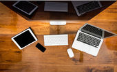 Computer ,laptop , tablet , smart phone on wood table — Stock Photo