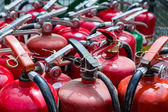 Old fire extinguishers — Stock Photo