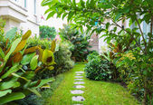 Flagstone path in home garden — Stock Photo