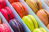 French colorful macarons in a rows — Stock Photo