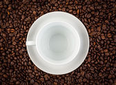 White ceramic cup on coffee background — Stock Photo