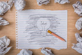Pencil erase and hand drawn light bulb on paper with Crumpled pa — Stock Photo