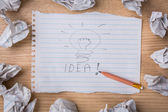 Hand drawn light bulb on paper with Crumpled paper — Stock Photo