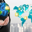 Business man holding the small world in his hand  (Elements of t — Stock Photo #51782351