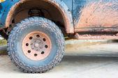 Muddy wheel — Stock Photo