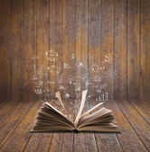 Magic book with business concept and graph — Stock Photo