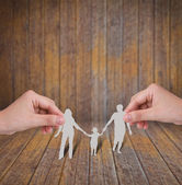 Hand with the paper cut of the family — Stock Photo