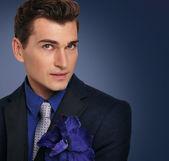 Elegant young man in jacket. Fashion model. — Stock Photo
