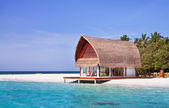 Landscape photo of beach house in Maldive ocean with blue sky — Stock Photo