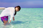 Beautiful fashion asian girl playing water in Maldive beach near — Stock Photo