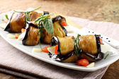 Eggplant rolls with cheese, tomato and basil — Stock Photo