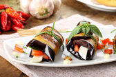 Eggplant rolls with cheese, tomato and basil — Stockfoto