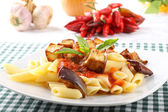 Pasta with tomato, basil and eggplant — Stock Photo