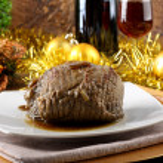 Roast beef with gravy — Stock Photo
