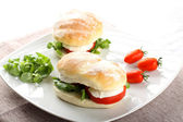 Sandwiches with mozzarella, tomato and lettuce — Stock Photo