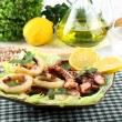 Fried squid with lettuce and lemon — Stock Photo
