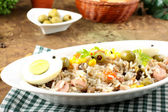 Rice salad with eggs, corn and olives — Stock Photo