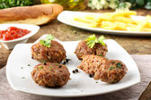 Meatballs with garlic, parsley and onion — Stock Photo