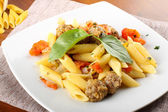 Pasta with meatballs, tomato and basil — Stock Photo