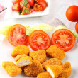 Chicken nuggets on dish — Stock Photo #15532029