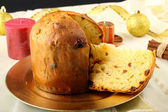 Table with panettone and christmas decorations — Stock Photo