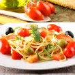 Spaghetti with fresh tomatoes, olives and mint — Stock Photo #16628185