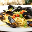 Pasta with mussels and cherry tomatoes - Stock Photo