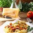 Pasta with fresh grouper fillet — Stock Photo