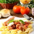 Pasta with tomato, sausage and ricotta — Stock Photo