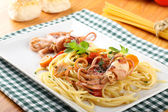 Pasta with octopus, tomatoes and carrots — Stock Photo