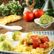 Noodles with broccoli, bacon and tomato — Stock Photo