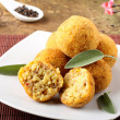 Arancini rice and meat - Stock Photo