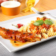 Fusilli pasta with pork and tomato sauce — Stock Photo