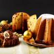 Christmas sweets on decorated table on complex background - Foto Stock